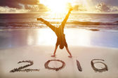 depositphotos_81207818-happy-new-year-2016.-young-man-handstand-on-the-beach